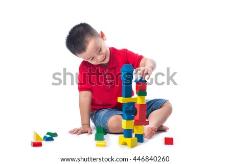 Asian kid boy playing with building blocks
