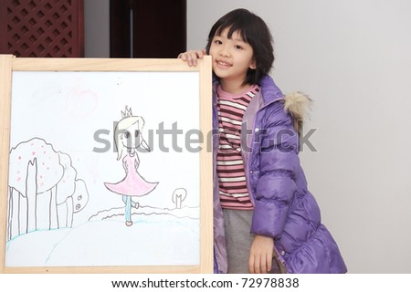 Asian kid drawing on the white board - stock photo