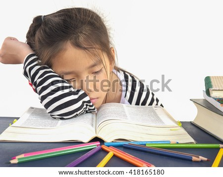 Asian kid is sleeping while reading a big book - stock photo