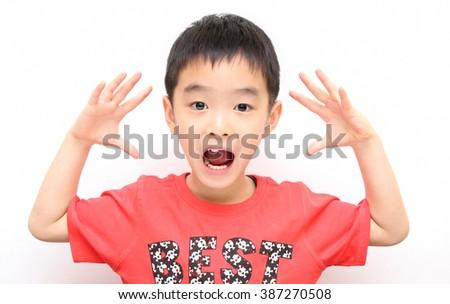 asian kid shouts something - stock photo