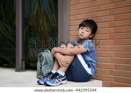 asian kid unhappy - stock photo