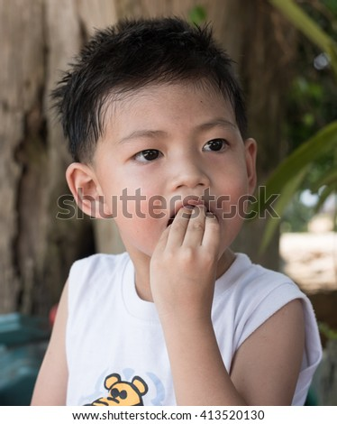 Asian kid with natural loose tooth.selective focus.