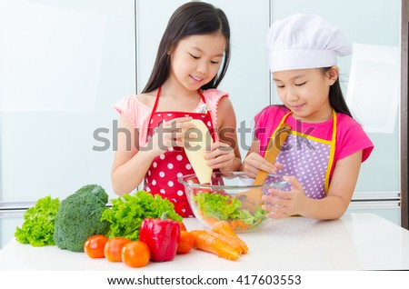 Asian kids enjoyed cooking