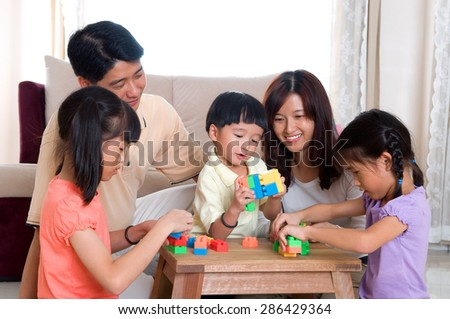 Asian kids playing building blocks