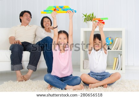 Asian kids showing off their building blocks