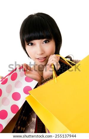 Asian lady holding colorful shopping bag, closeup portrait. - stock photo