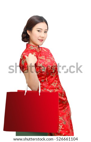 Asian lady in red cheongsam dress(qipao) holding red shopping bag isolated on white background, Happy chinese new year