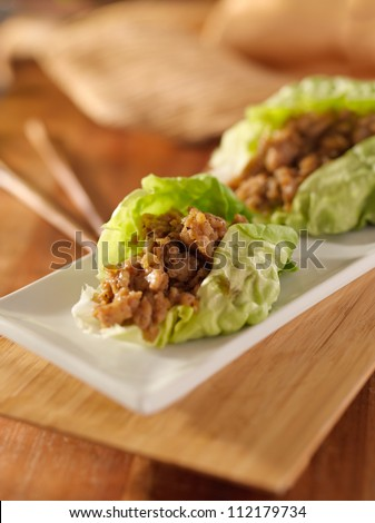 Asian lettuce wrap with minced chicken and seasonings - stock photo