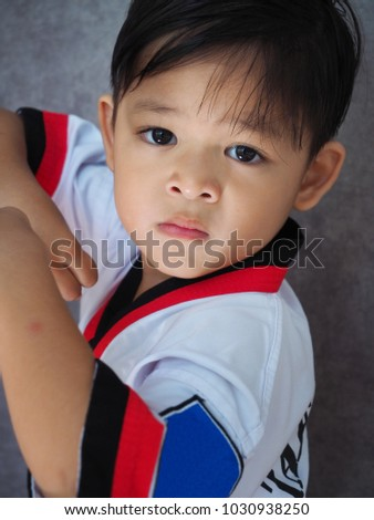 Asian Little Boy in Taekwondo Uniform with Strong Attitude