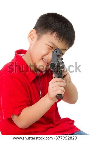Asian Little Boy Playing Plastic Toy AK47 on White Background
