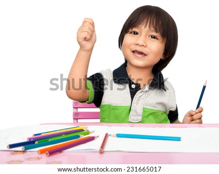Asian Little Boy smiling and happy while drawing sketch