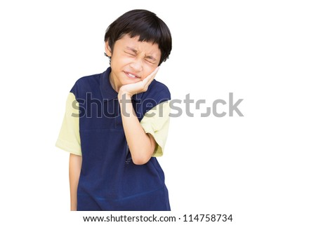Asian little boy standing with his hand on his mouth suffering from a sore tooth,  Isolated over white - stock photo