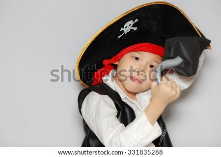 Asian little boy wear pirate costume for halloween