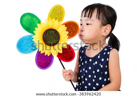 Asian Little Chinese Girl Blowing Colorful Windmill isolated on White Background - stock photo