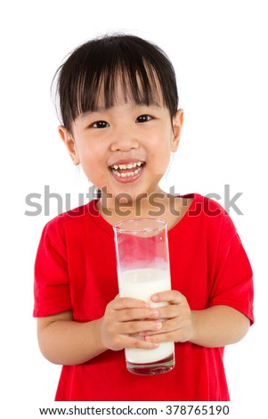 Asian Little Chinese Girl Holding a cup of Milk isolated on White Background - stock photo