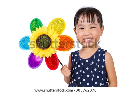 Asian Little Chinese Girl Holding Colorful Windmill isolated on White Background - stock photo