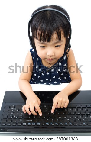 Asian Little Chinese Girl in Headset with Laptop isolated on White Background