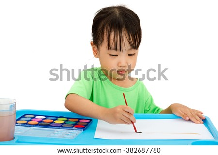 Asian Little Chinese Girl Painting with Brush at Home