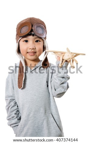 Asian Little Chinese Girl Playing with Toy Airplane in isolated White Background - stock photo
