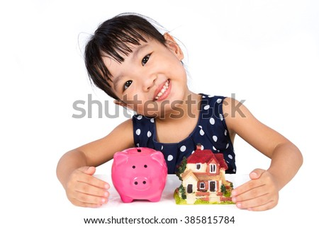 Asian Little Chinese Girl Saving Money for Property Concept isolated on White Background