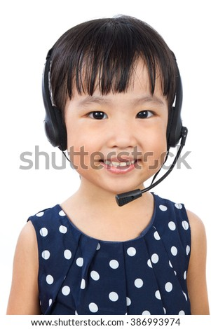 Asian Little Chinese Girl Wearing Headset isolated on White Background - stock photo