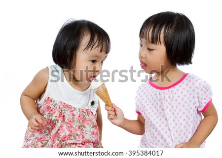 Asian Little Chinese Girls Eating Ice Cream isolated on White Background