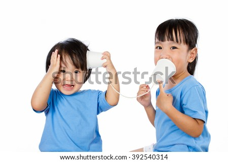 Asian Little Chinese Girls Playing with Paper Cups isolated on White Background - stock photo