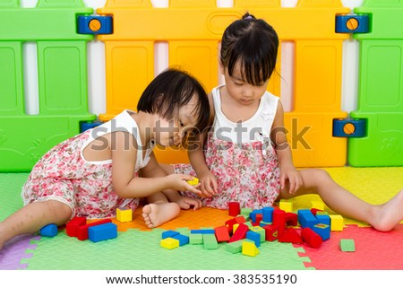 Asian Little Chinese Girls Playing Wooden Blocks at Home or Kindergarten - stock photo