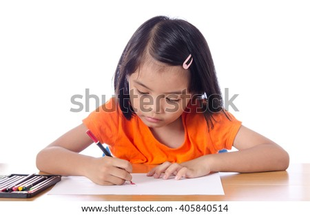 Asian little girl are happy to paint a picture on her desk
