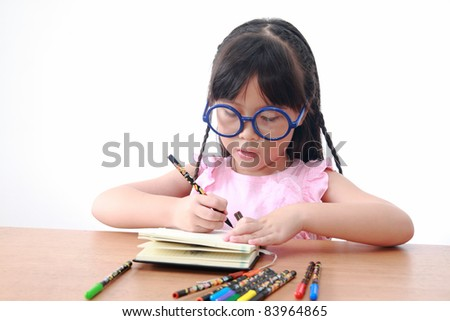 Asian little girl draw on a book isolated on a over white background
