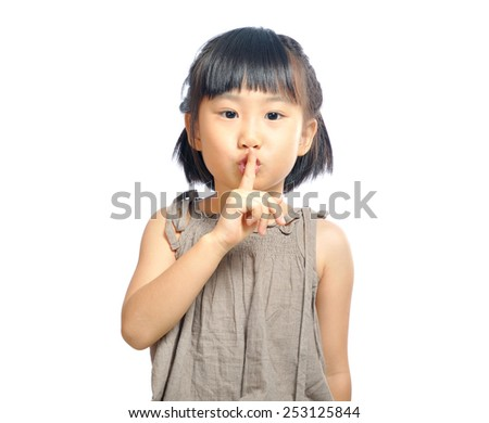 asian little girl finger up to lips for making a quiet gesture isolated on white background - stock photo
