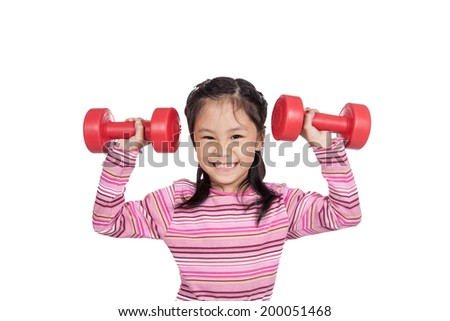 Asian little girl hold  dumbbells with both hand isolated on white background