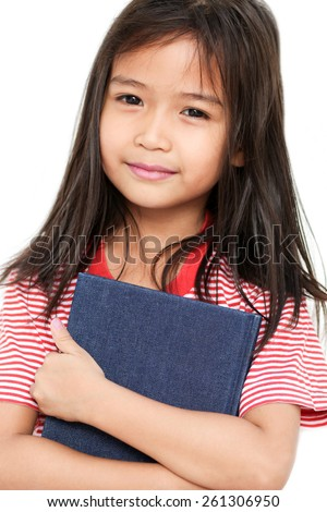 Asian little girl holding a big book. Isolated on white background - stock photo