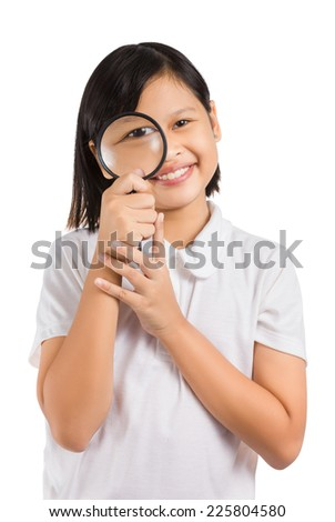 Asian little girl holding a magnifying glass isolated on white background. - stock photo