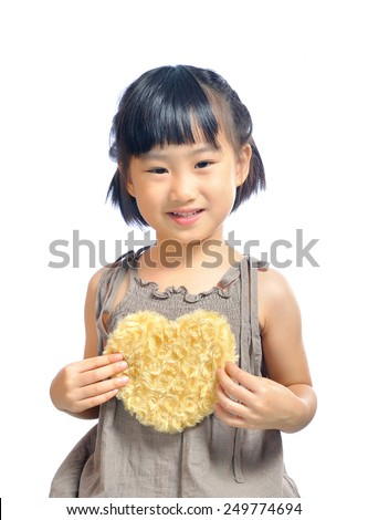 Asian little girl holding a pouch shape as heart isolated on white background - stock photo