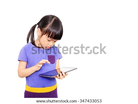 Asian little girl playing with tablet