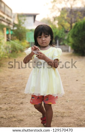 Asian little girl standing in outdoor