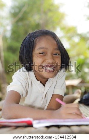Asian little girl, student in countryside