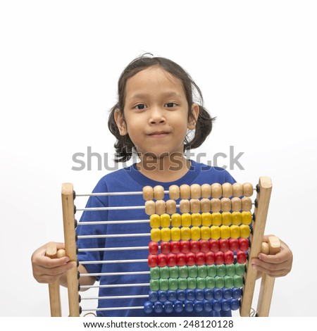 Asian little girl wearing blue shirt holding a abacus over white background