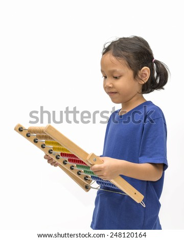 Asian little girl wearing blue shirt holding a abacus over white background - stock photo