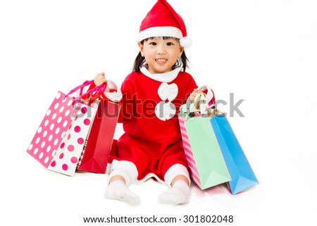 Asian Little Santa Claus with shopping bag in white isolated background - stock photo