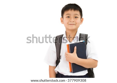 Asian Little School Boy Holding Books with Backpack on White Background - stock photo