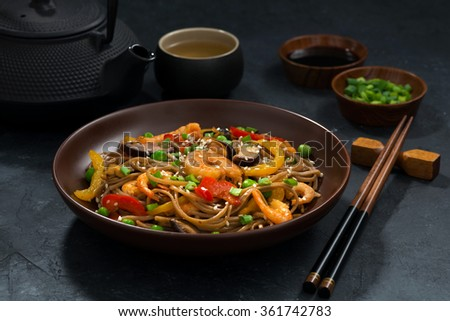 Asian lunch. Buckwheat noodles with seafood, closeup