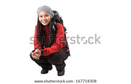 Asian Malay female with warm clothing hiking attire and backpack. - stock photo