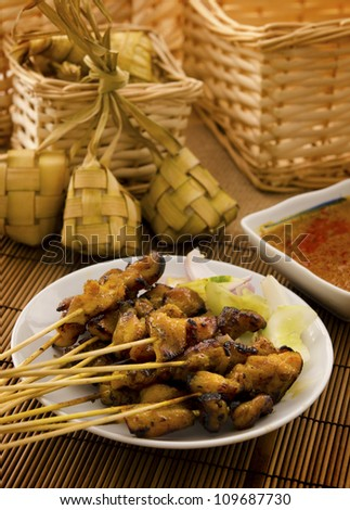 Asian Malay Ramadan food, satay chicken and ketupat in low light - stock photo