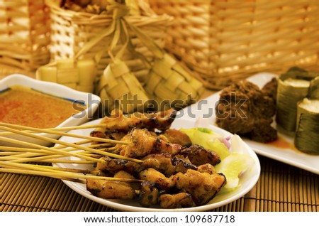 Asian malay Ramadhan foods, satay chicken, rendang, lemang and ketupat - stock photo