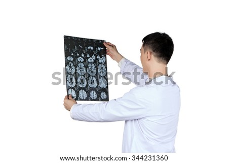 asian male doctor looking at brain x-ray radiographic image, ct scan, mri, radiology department, isolated on white - stock photo