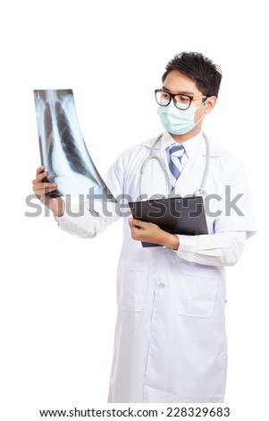 Asian male doctor wear mask look at x-ray film  isolated on white background