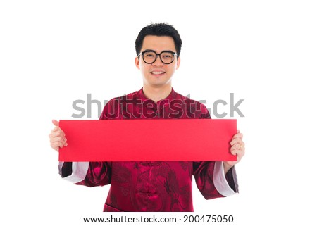 asian male with chinese new year banner - stock photo