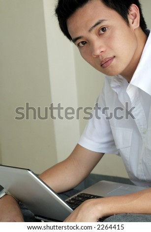 Asian Male working with Laptop